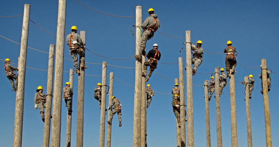 Workers on poles